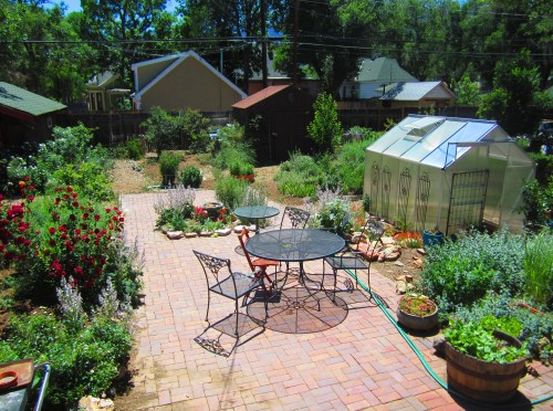 "Now here's a ""before"" picture of the garden in early June. ""Before meaning before a summer of distractions, publishing a book, fires and floods, etc. A bit more orderly for Lily's graduation party."