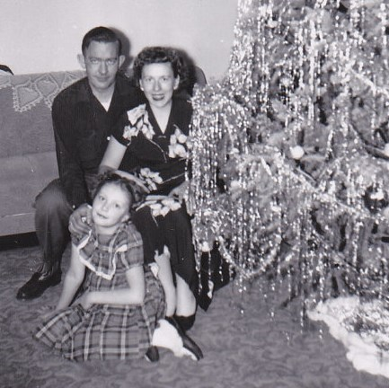 1940s family with their tinsel-decorated tree.